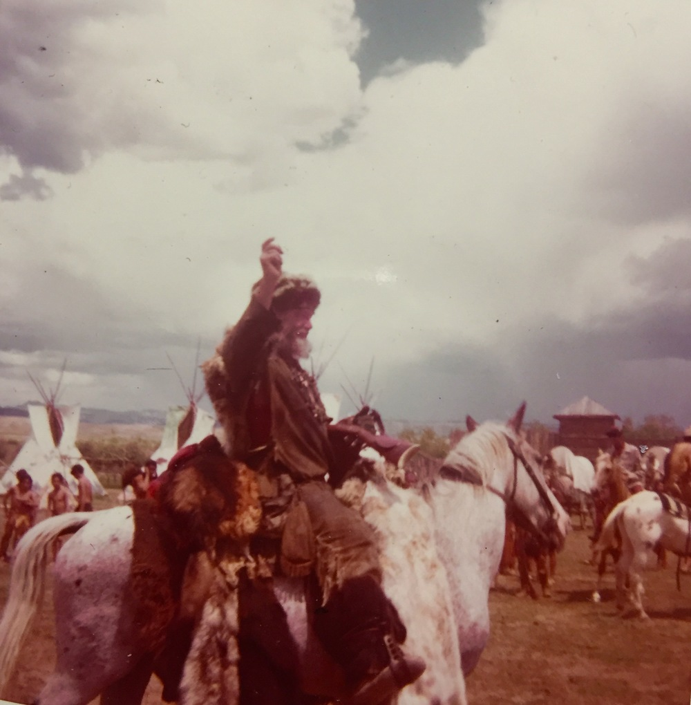 Modern day mountain man Timberjack Joe and his dog, Tuffy (riding on the horse behind Timberjack) at the Pinedale, Wyoming Rendezvous, July, 1974. Photo by Bobby Bridger