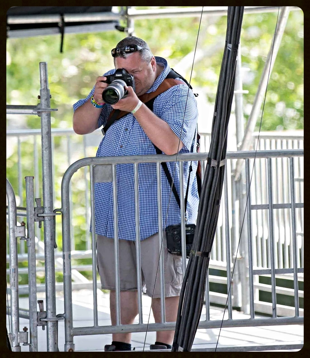 Sterling Munksgard photographing at Bottle Rock Napa.  Photo by Mitchell Glotzer.