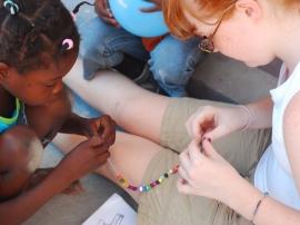 HAITI - making bracelets.JPG