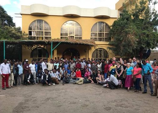 The gathered conference celebrating our 10 years of partnership work, including Vineyard leaders from two neighboring African nations: Kenya and Uganda.