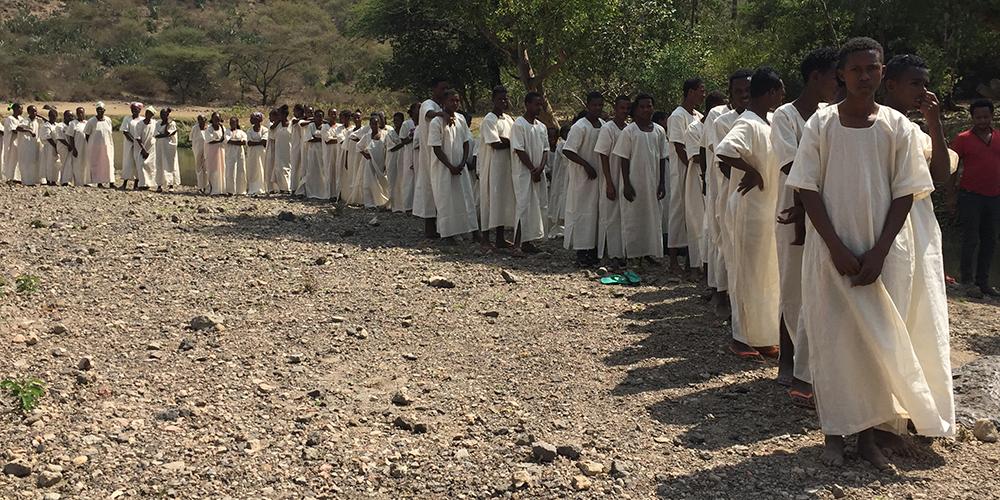 IMAGE - STORY - BANNER - 10YRS ETHIOPIA - Babtism Line (Chuck W).jpg
