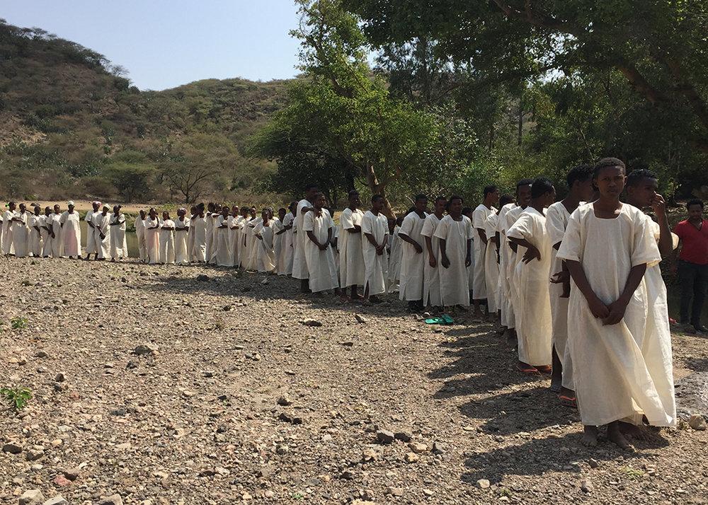 IMAGE - STORY - 10YRS ETHIOPIA - Babtism Line (Chuck W).jpg