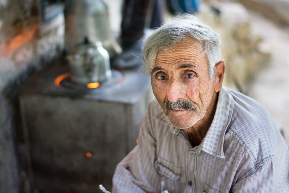 Hasan     Eroğlu     makes tea on the porch of his home in     Şorşvenk     village.