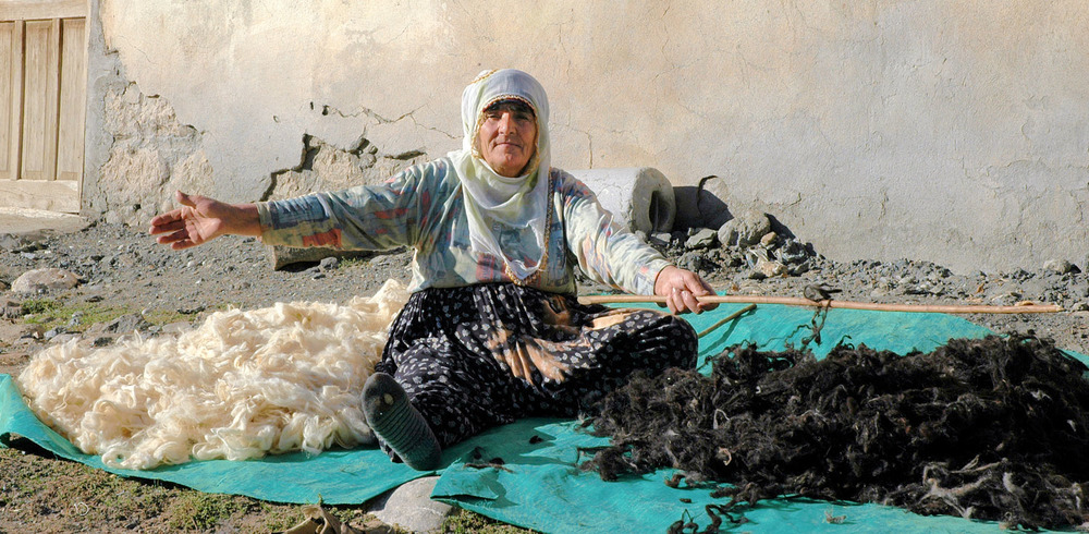 A woman in Ovacik beats sheared wool, to clean it.