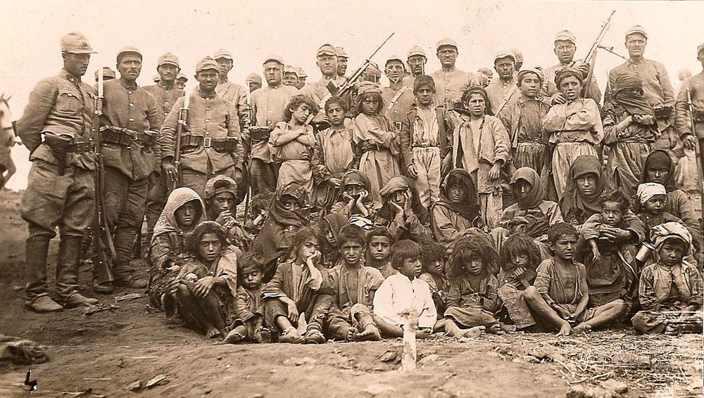 Prisoners in Dersim, held captive by the uniformed Turkish soldiers standing in rear.