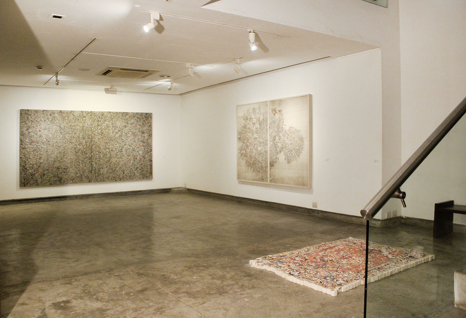 """G R Iranna, """"Ether is all that is"""", 21 January – 9 March 2017, Gallery Espace, New Delhi. Installation view with 'Psychic Sound', 2016, acrylic on tarpaulin, 66 x 120 in (Left) and 'Beautiful Burning Tree', 2016, silver foil on paper 60 x 80 (Right). Image courtesy Gallery Espace."""
