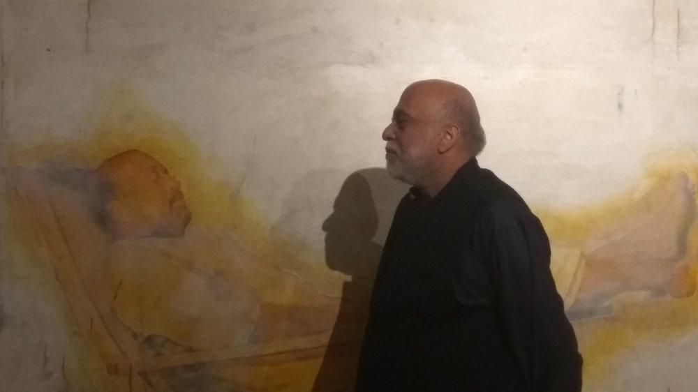The artist with his unfinished self-portrait. Image courtesy Gallery Threshold. Photo: Manisha Gera Baswani.