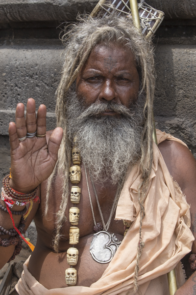 A sadhu at Nashik. I love this guys skull necklace carved from bones.