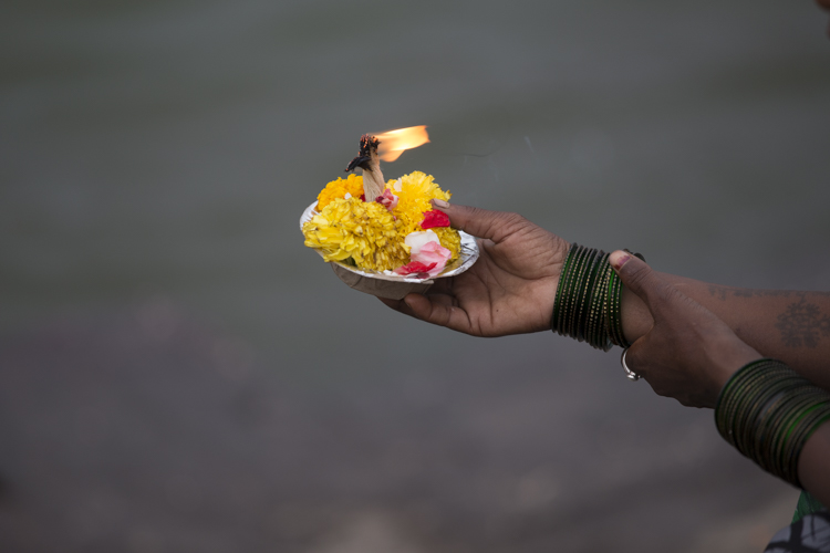 An offering (or Puja) about to be placed in the Godavari River.