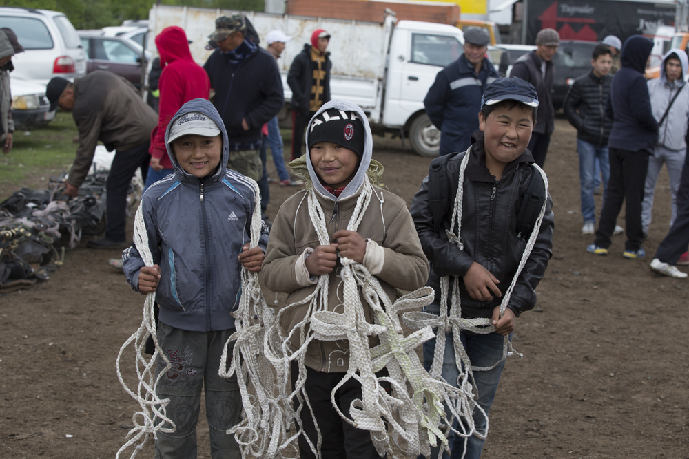 Kids selling harnesses - In Kyrgyzstan it's considered extremely bad luck to sell a horse with its harness.
