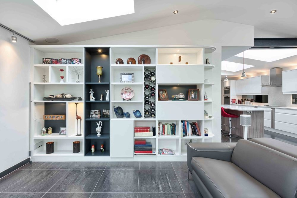 Seating area with a bookshelf  of a modern house extension by Harvey Norman Architects St Albans
