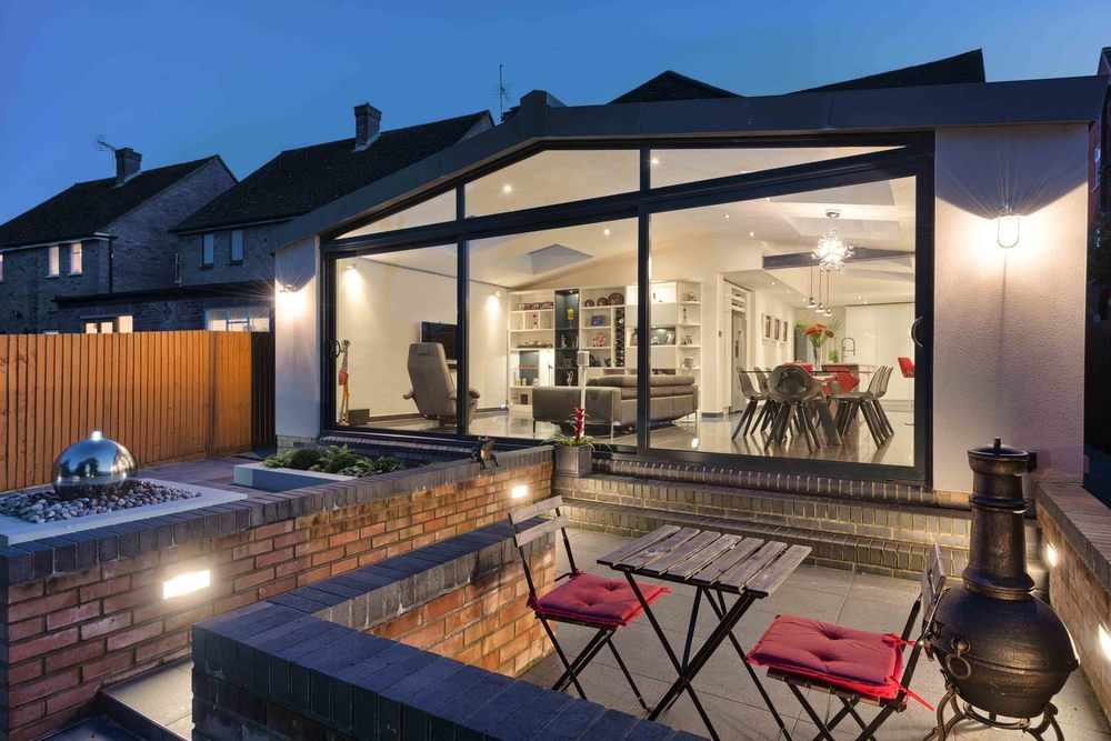 Outside sitting area of a modern house extension by Harvey Norman Architects St Albans
