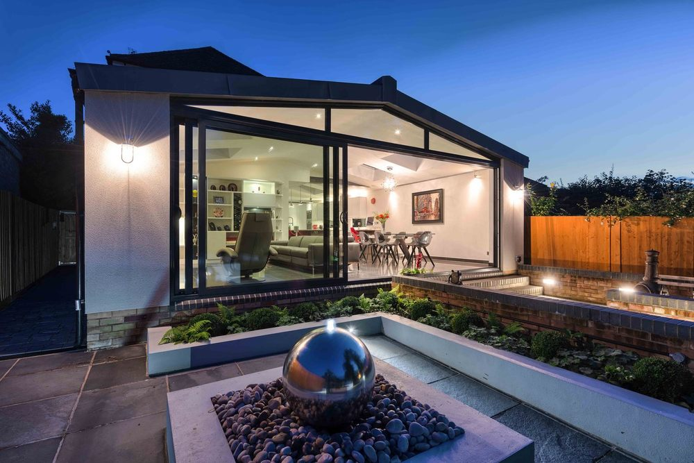 Garden centre piece  of a modern house extension by Harvey Norman Architects St Albans