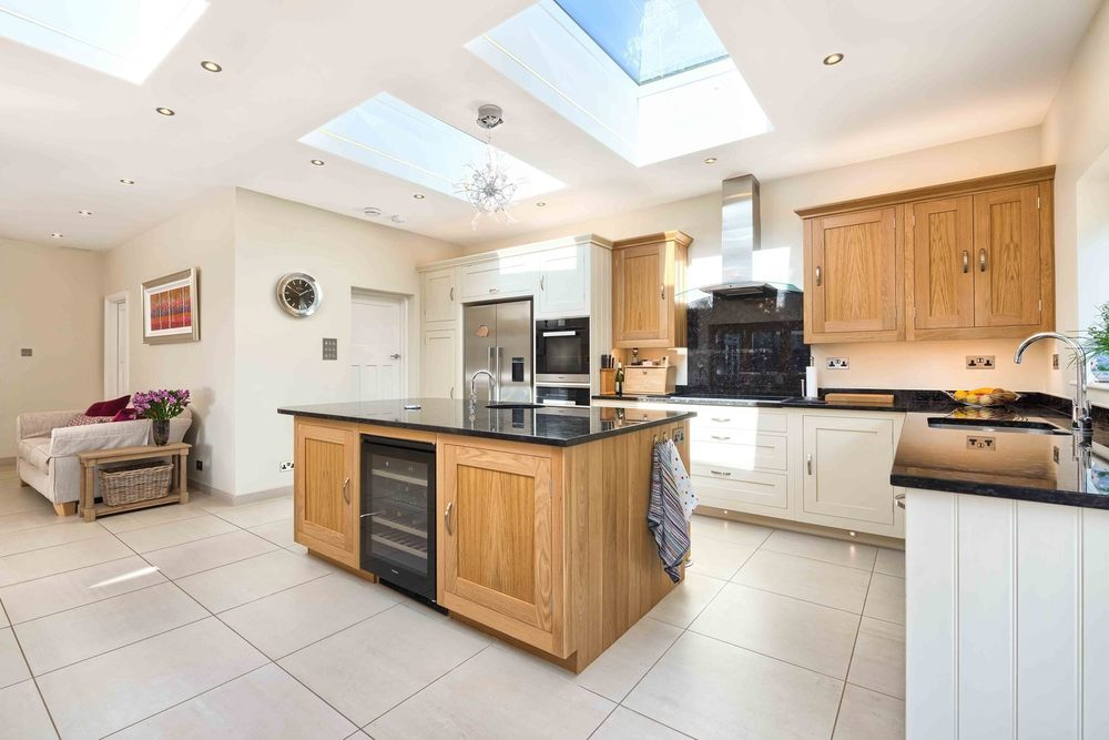 A kitchen with lots of light from a modern house extension by Harvey Norman Architects St Albans