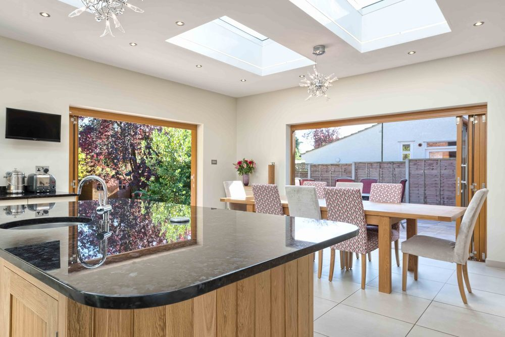 The kitchen counter and dining room a house extension by Harvey Norman Architects St Albans