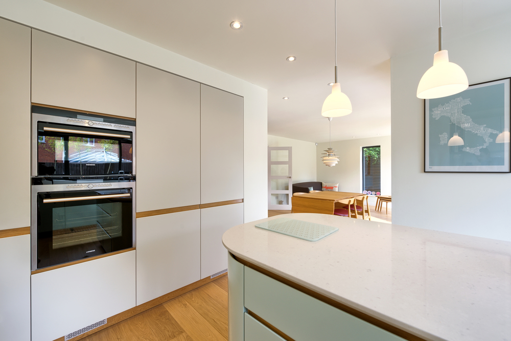 Kitchen counter and lighting of a Scandinavian house extension by Harvey Norman Architects Bishop's Stortford
