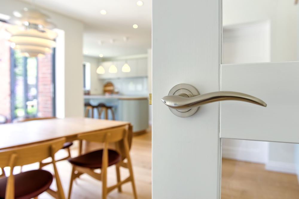 Door handle of a Scandinavian house extension by Harvey Norman Architects Bishop's Stortford