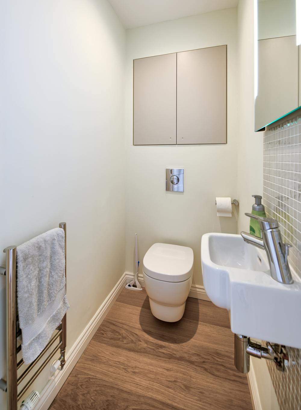 Downstairs toilet of a Scandinavian house extension by Harvey Norman Architects Bishop's Stortford