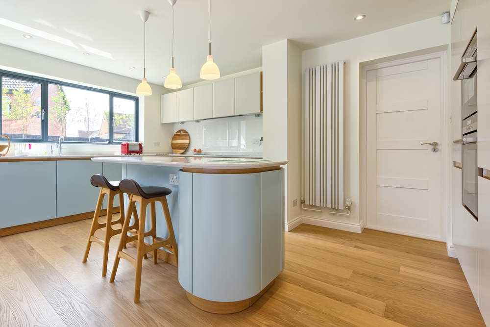 Breakfast bar and stools of a Scandinavian house extension by Harvey Norman Architects Bishop's Stortford