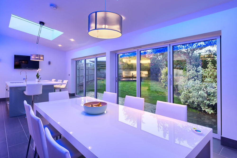 Blue light garden view of a lighting house extension by Harvey Norman Architects Cambridge