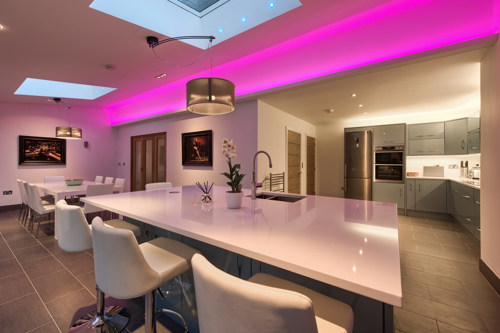 Purple light of a lighting house extension by Harvey Norman Architects Cambridge