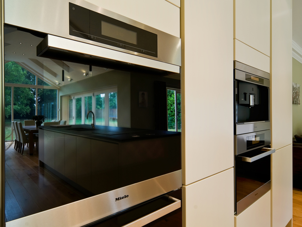 Closeup of appliances of a house extension by Harvey Norman Architects Cambridge