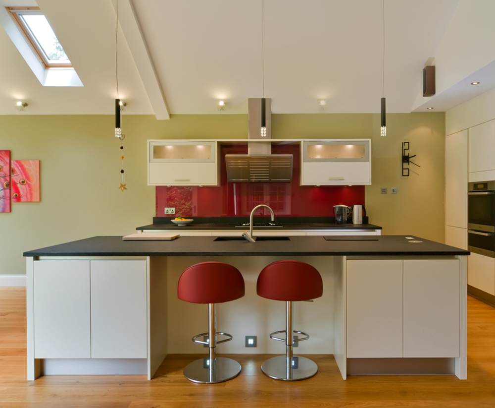 Kitchen breakfast bar stool of a house extension by Harvey Norman Architects Cambridge