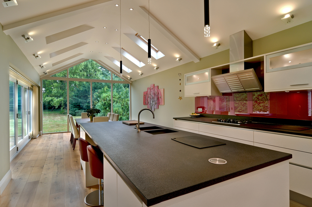 Island counter of a house extension by Harvey Norman Architects Cambridge