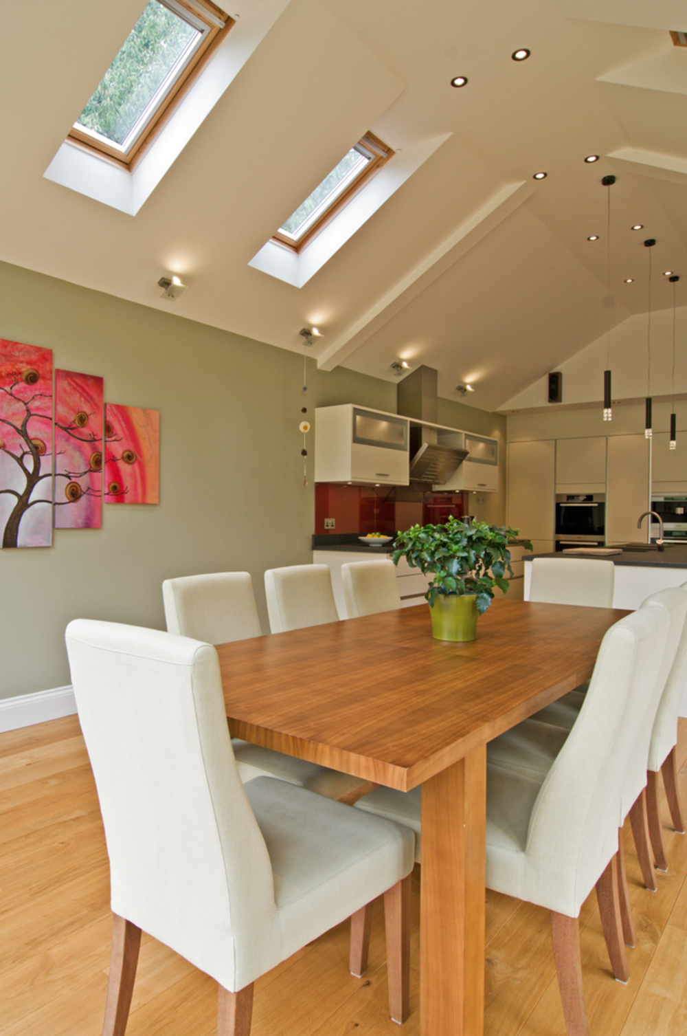 Dining room table of a house extension by Harvey Norman Architects Cambridge