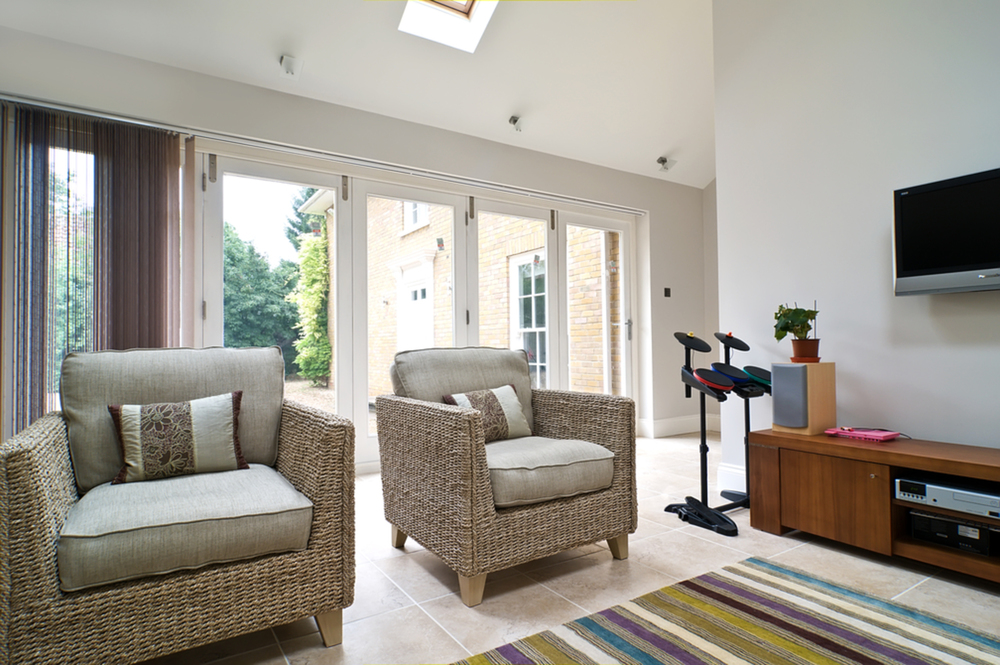 Sitting room of a house extension by Harvey Norman Architects Cambridge