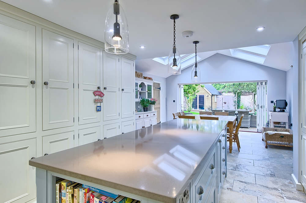 Kitchen island counter of a house redesign by Harvey Norman Architects Cambridge