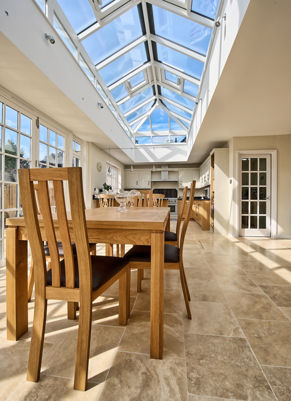 Skylight and dining room table of a house extension by Harvey Norman Architects St Albans