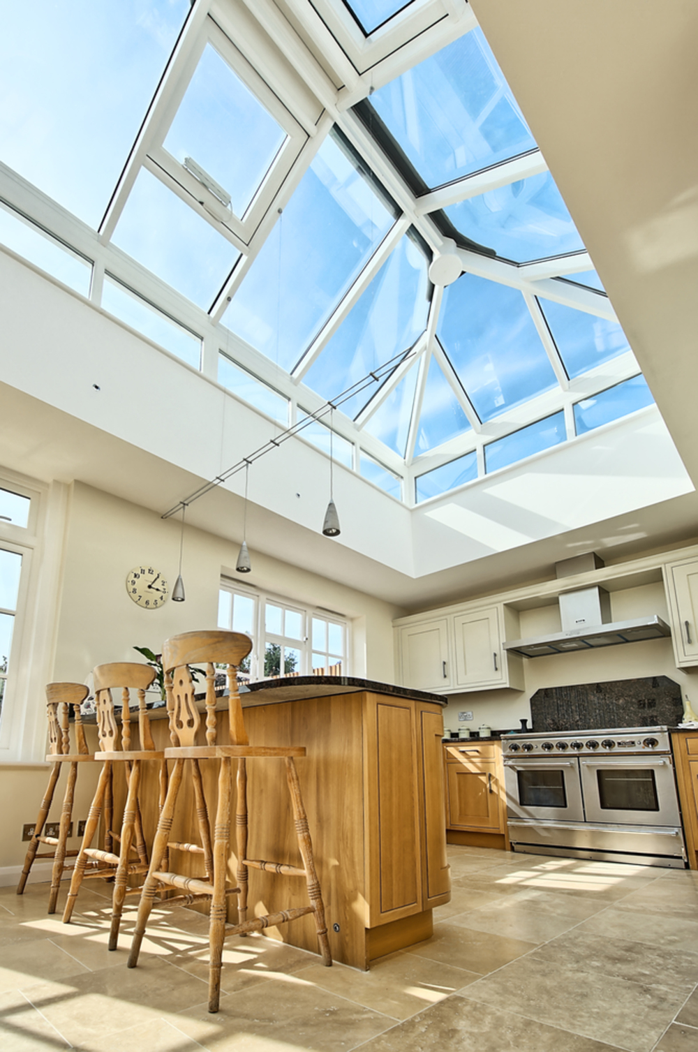 Breakfast bar stools and skylight of a house extension by Harvey Norman Architects St Albans