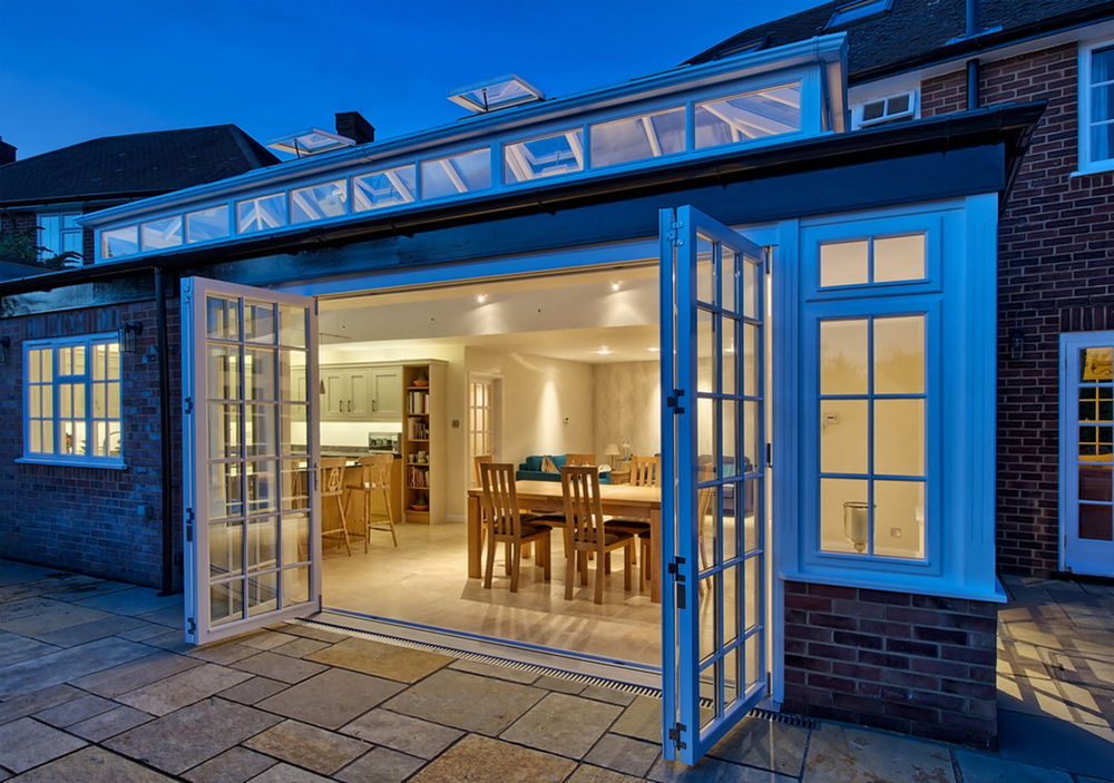 Outside sliding doors night lighting of a house extension by Harvey Norman Architects St Albans
