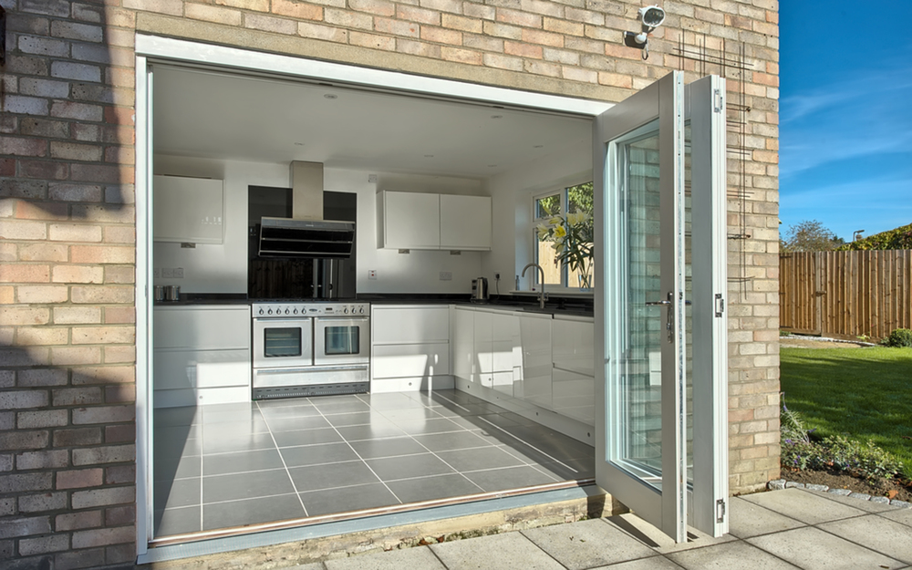Sliding doors view into kitchen of a house extension by Harvey Norman Architects Cambridge