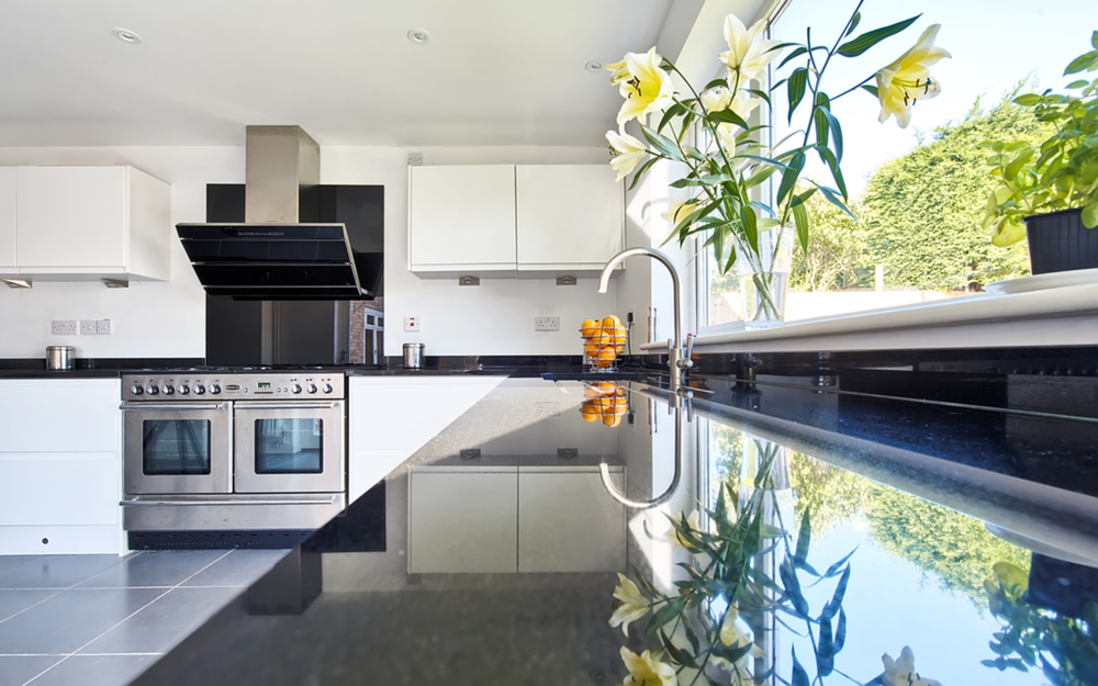 Kitchen counter and sink of a house extension by Harvey Norman Architects Cambridge