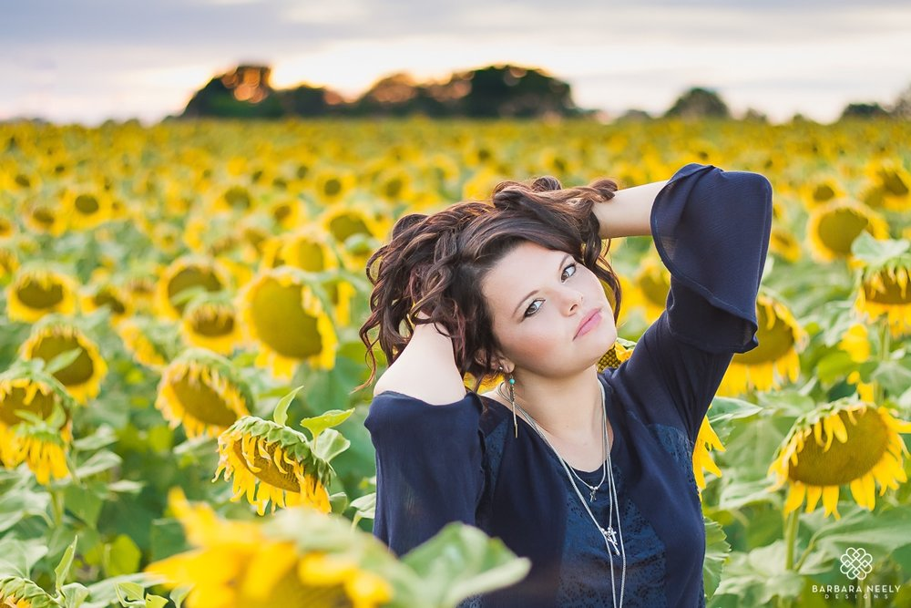 Stunning senior girl in a sunflower field