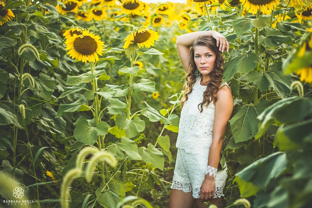 Beautiful senior girl in sunflower field in Southwest Missouri