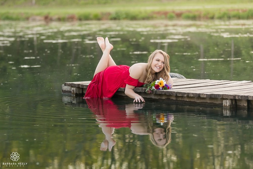 senior pictures on a boat dock in the lake_ 4181.jpg