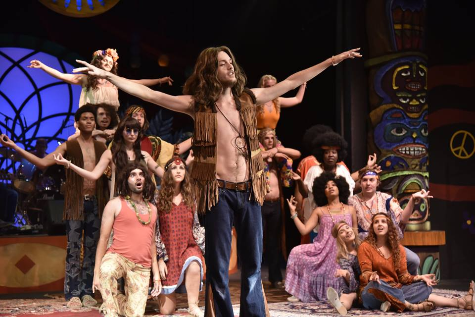 Tyler (front) performing Donna in  HAIR  at Theatre UCF