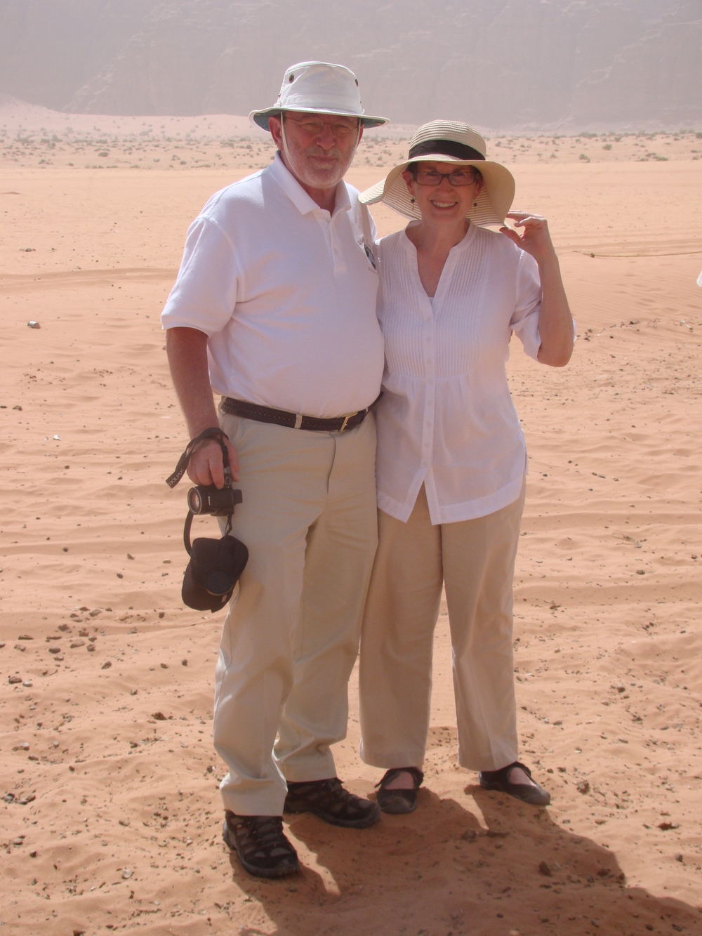 Senior arawjotours tour leader / representative joe mccarthy with his wife Margie in wadi rum, jordan.