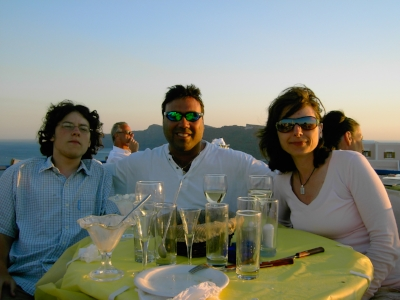 My family and I enjoying a rooftop sunset in Oia, Santorini