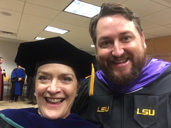 Dean Stacy Haynie and Jay Ducote celebrate after LSU's commencement.
