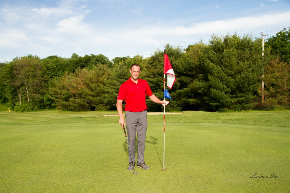 Golfer with flag.jpg