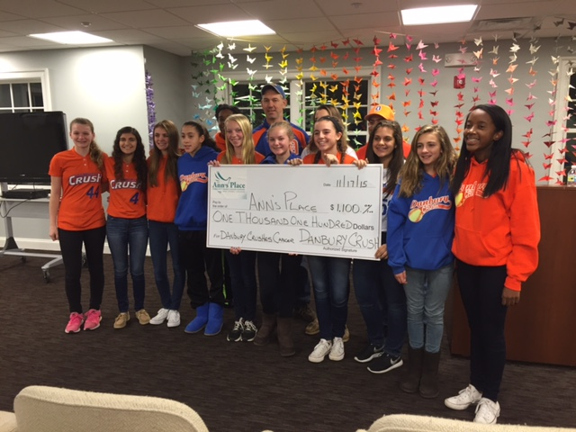 Danbury Crush 14 U fast pitch softball team presents a check to Ann's Place