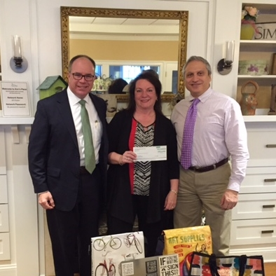 Above: Scott Cooney & Marie Borner of Coldwell Banker, Anthony Zeolla, CPA, President of Ann's Place