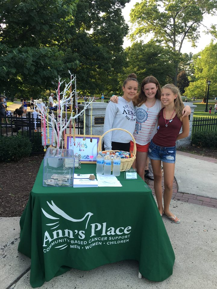 Kiralyse Hermann (left) and friends host an information/donation table at a community concert in Ridgefield's Ballard Park.