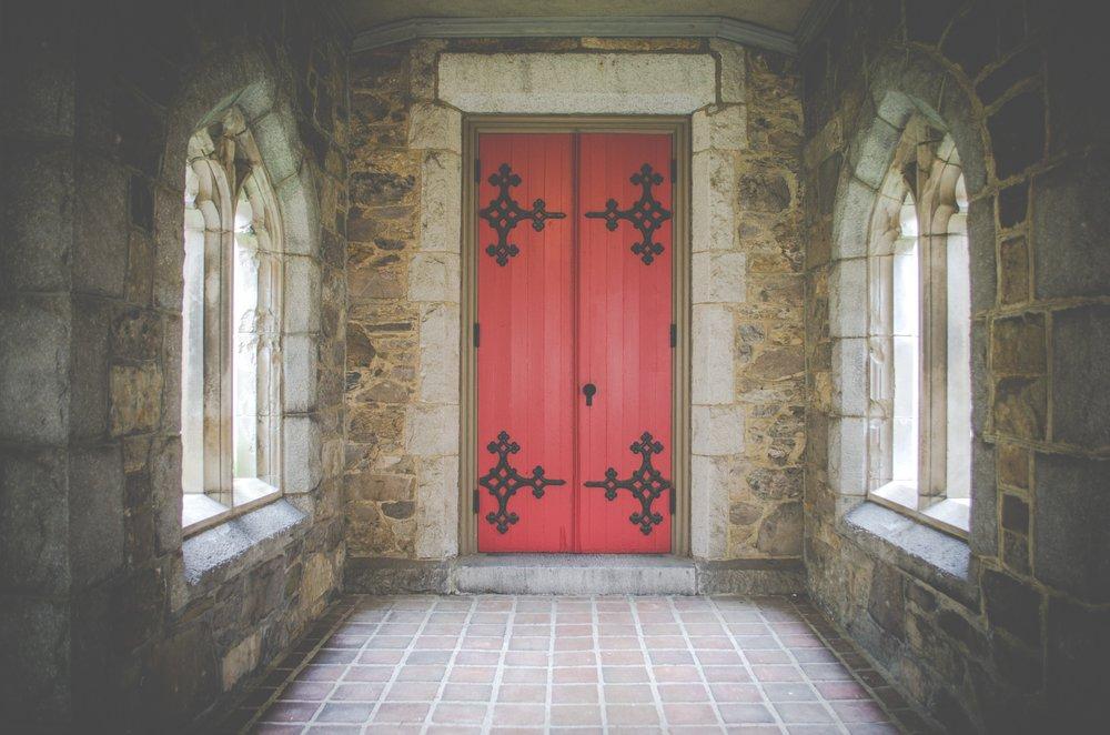Wooden door white arches.jpg