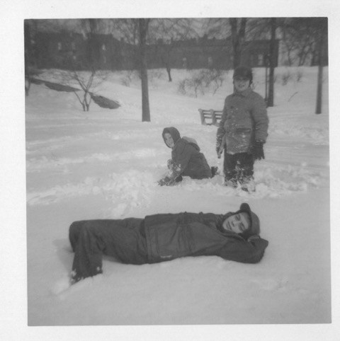 Mayer lying in the snow.jpeg