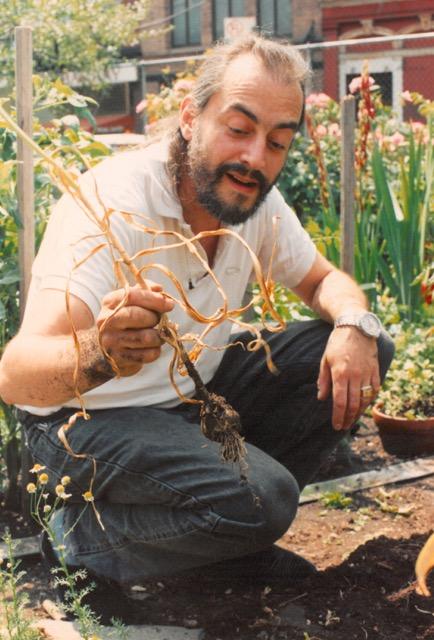 Mayer holding garlic.jpeg